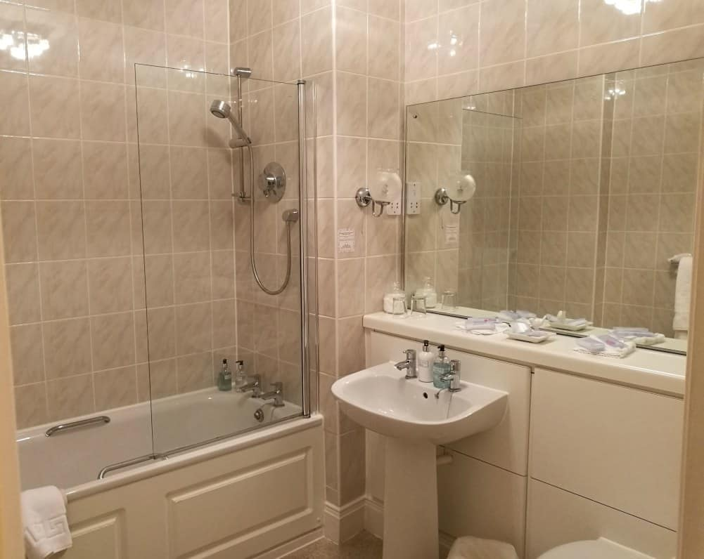the bathroom in the suite at the Moorland Garden Hotel