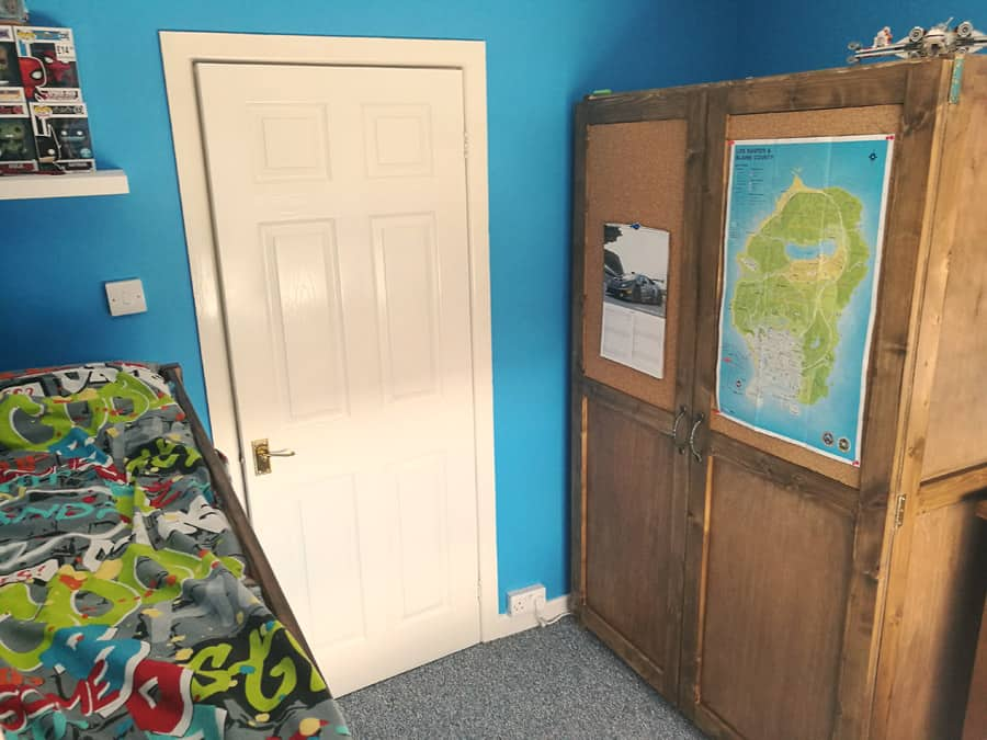 Teenager's blue bedroom with cork board wardrobe DIY different angle