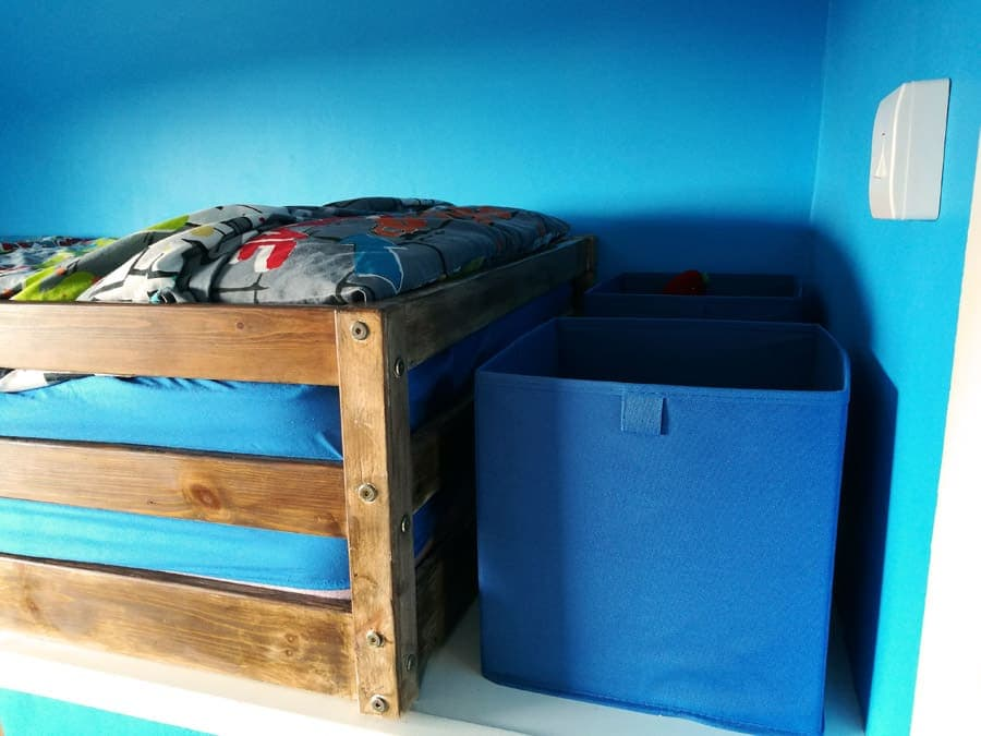 Top end of the boxroom bed with storage boxes