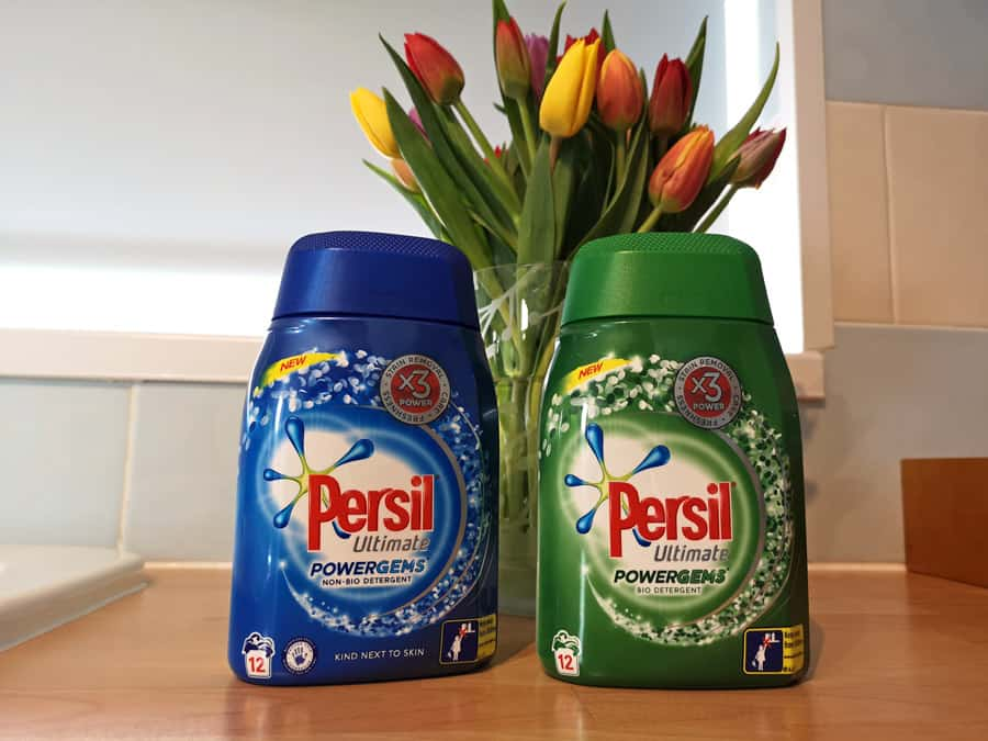 Persil Powergems with flowers in the background