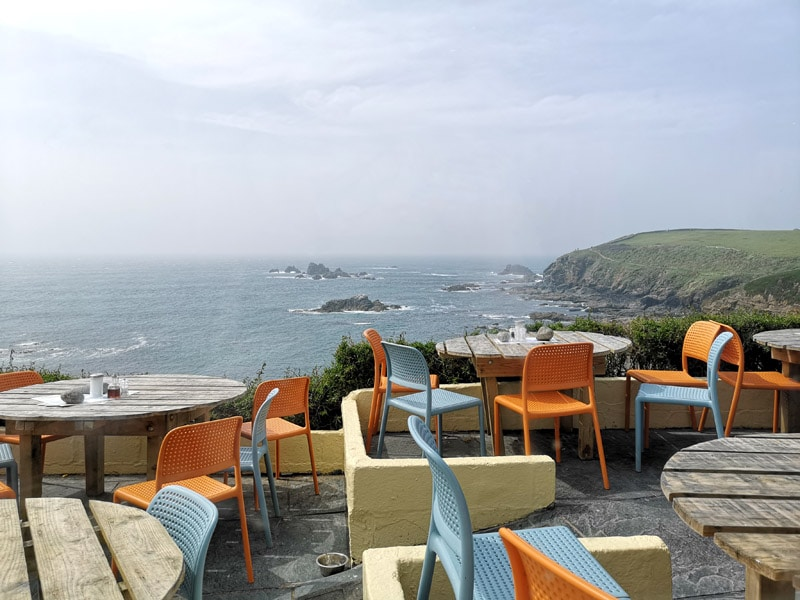 Polpeor cafe outside seating area with sea views